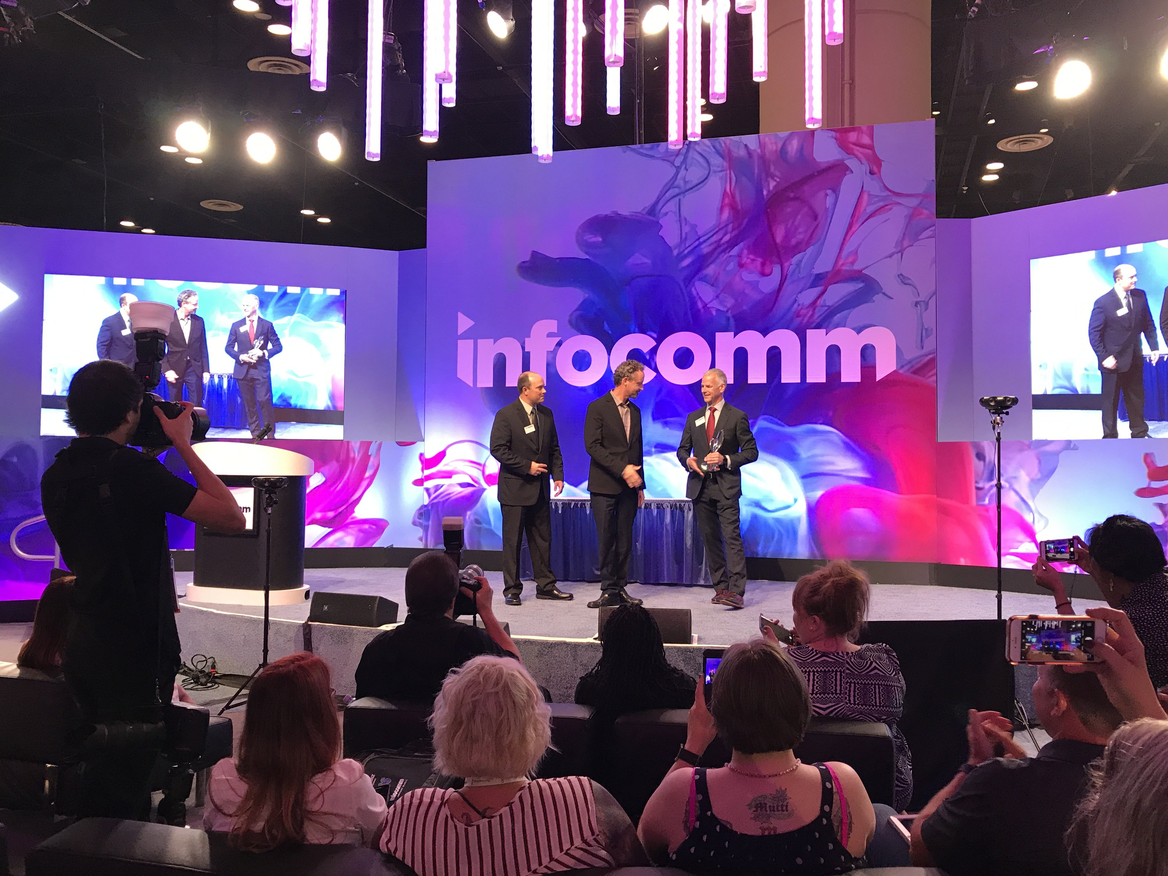 InfoComm 2017 Center Stage with three men on stage (background)