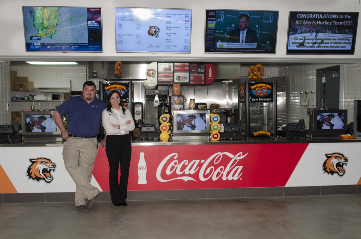 RTI Hockey Arena Concession Stands with a man and a woman
