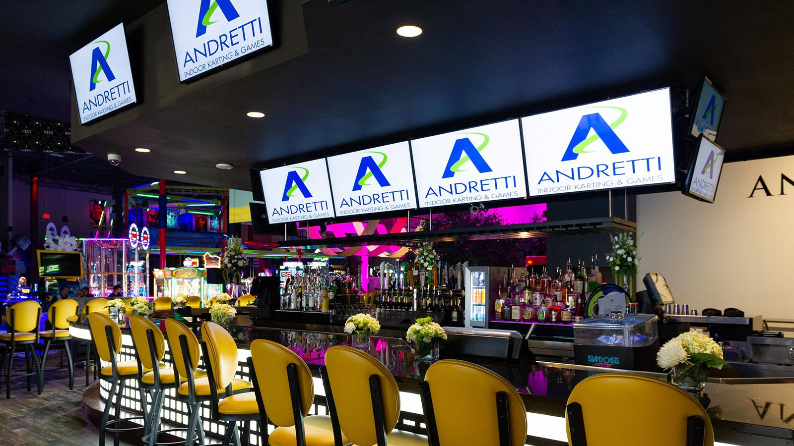Andretti Indoor Go Karting facility bar area with several television displays. (background)