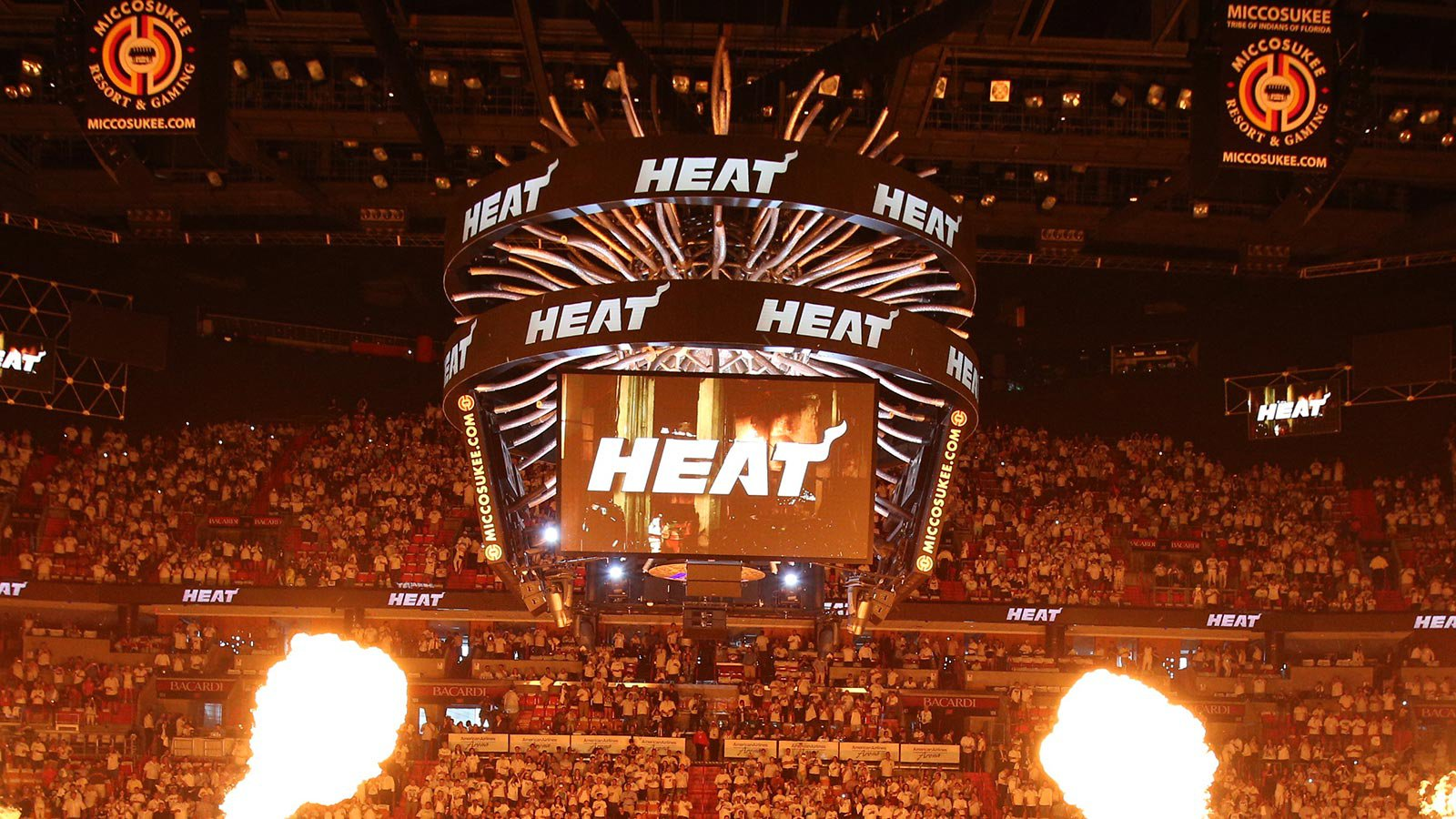 Miami Heat basketball arena with packed crowd, video screens, and fire effects. (background)