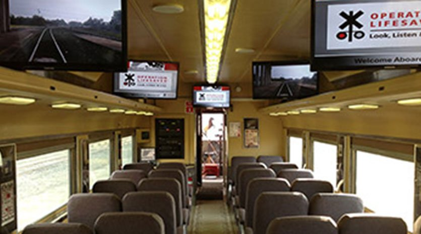 Bus with televisions mounted to the interior roof