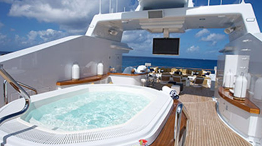 Deck of a yacht with a hot tub and television screen